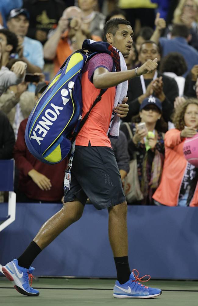 Nick Kyrgios, of Australia, waves to the fans after losing to Tommy Robredo, of Spain, 3-6, 6-3, 7-6 (4), 6-3 in the third round of the U.S. Open tennis tournament Sunday, Aug. 31, 2014, in New York