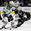 Los Angeles Kings center Trevor Lewis, right, knocks the puck away from Dallas Stars center Tyler Seguin during the third period of an NHL hockey game in Los Angeles, Thursday, Nov. 13, 2014. The Stars won 2-0 The Associated Press