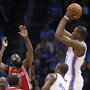 Oklahoma City Thunder forward Kevin Durant (35) shoots over Houston Rockets guard James Harden (13) during the second quarter of an NBA basketball game in Oklahoma City, Tuesday, March 11, 2014. Oklahoma City won 106-98 The Associated Press