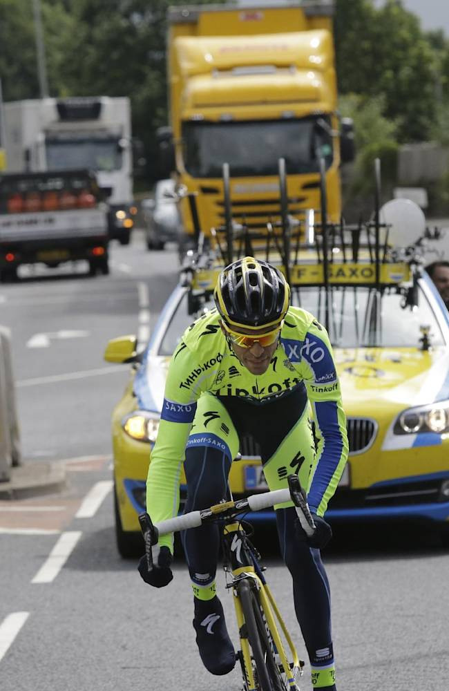 Spain's Alberto Contador catches up with his teammates during a training ride ahead of the Tour de France cycling race in Leeds, Britain, Thursday, July 3, 2014. The Tour de France will start on Saturday July 5 in Leeds, and finishes in Paris on Sunday July 27