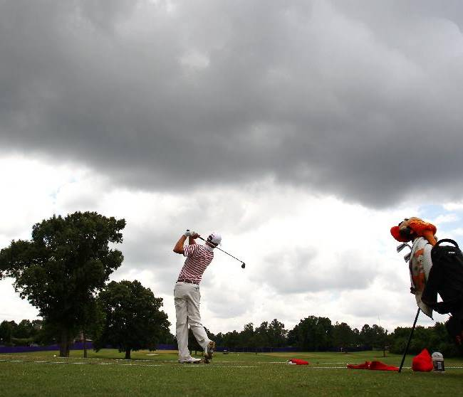 Memphis native Zachary Olsen takes practice shots at the driving range during practice for the St. Jude Classic golf tournament, Tuesday, June 3, 2014, in Memphis, Tenn