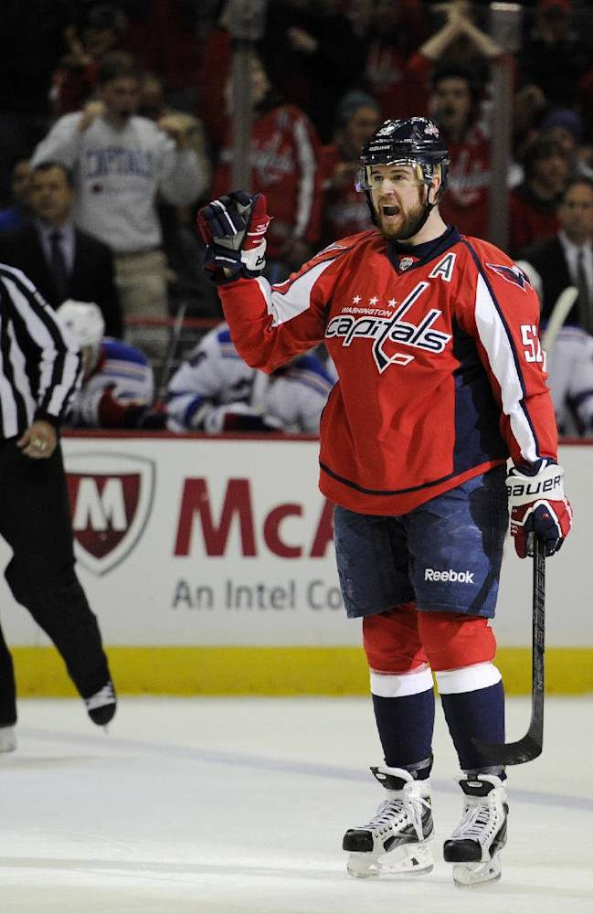 Washington Capitals defenseman Mike Green (52) celebrates his goal against the New York Rangers during the first period an NHL hockey game, Friday, Dec. 27, 2013, in Washington