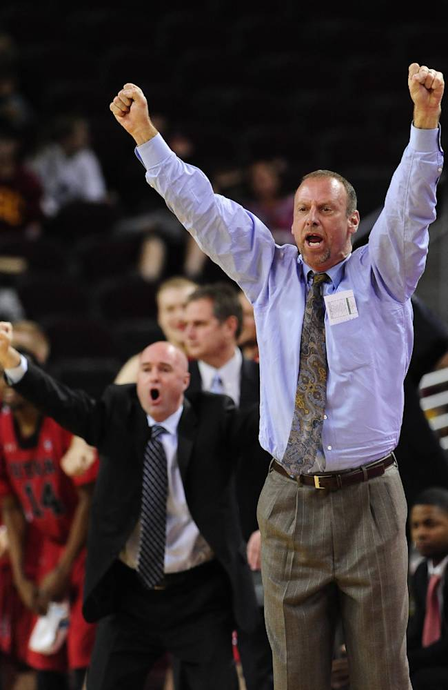 Utah head coach Larry Krystkowiak reacts during the second half of an NCAA college basketball game against Southern California, Thursday, Feb. 13, 2014, in Los Angeles. Utah won 79-71