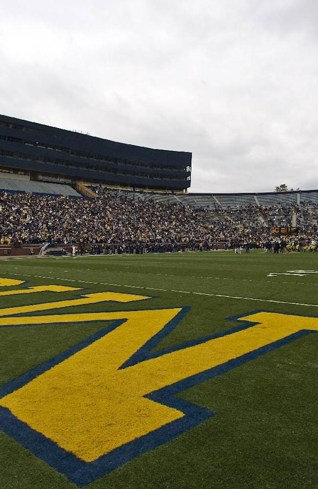 Michigan Stadium, with newly constructed structures containing luxury suites and a new press box, filled with 35,000 to watch the Wolverines' spring football game, Saturday, April 17, 2010, in Ann Arbor, Mich