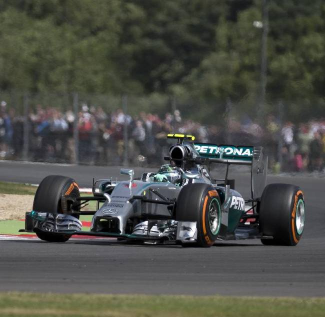 Germany's Nico Rosberg of Mercedes rounds the track during a practice session before the British Formula One Grand Prix at Silverstone, England, Friday, July 4, 2014. The British Formula One Grand Prix will be held on Sunday, July 6, 2014