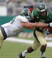 Cal Poly defensive lineman Sullivan Grosz, left, pulls down Colorado State running back Donnell Alexander after a short gain in the second quarter of an NCAA college football game in Fort Collins, Colo., on Saturday, Sept. 14, 2013. (AP Photo/David Zalubowski)