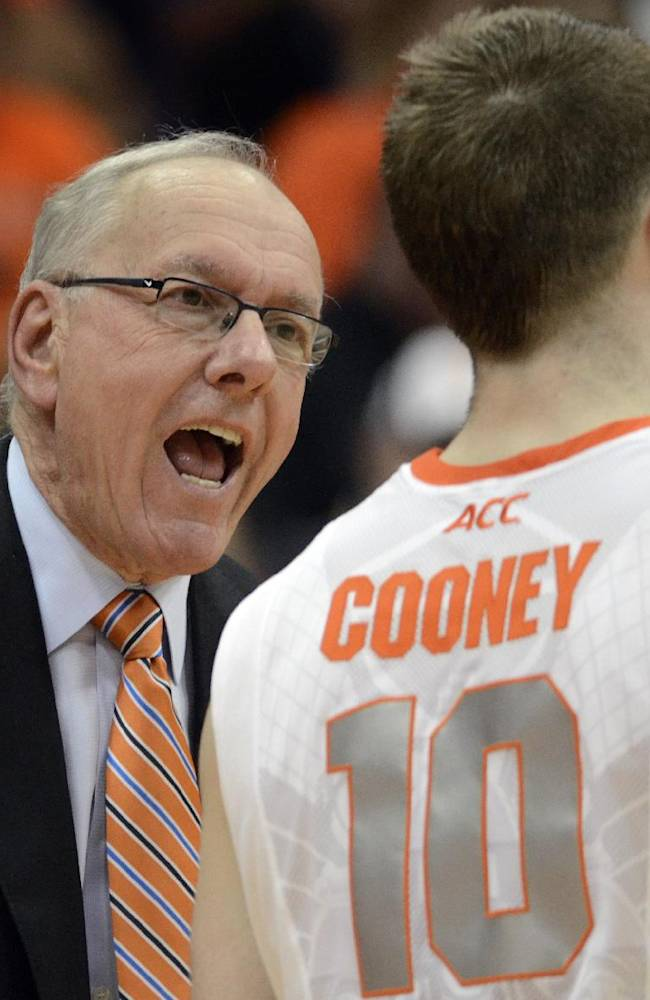 Syracuse head coach Jim Boeheim yells at Trevor Cooney during the first half against St. Francis in an NCAA college basketball game in Syracuse, N.Y., Monday, Nov. 18, 2013