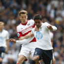 Tottenham Hotspur's Paulinho, right, tussles with Fulham's Scott Parker during their English Premier League soccer match at White Hart Lane, London, Saturday, April 19, 2014