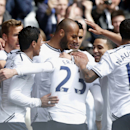 Tottenham Hotspur's Younes Kaboul, center, celebrates his goal against Fulham with teammates during their English Premier League soccer match at White Hart Lane, London, Saturday, April 19, 2014