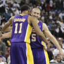 Lakers beat Kings 106-100, await Bryant's return The Associated Press