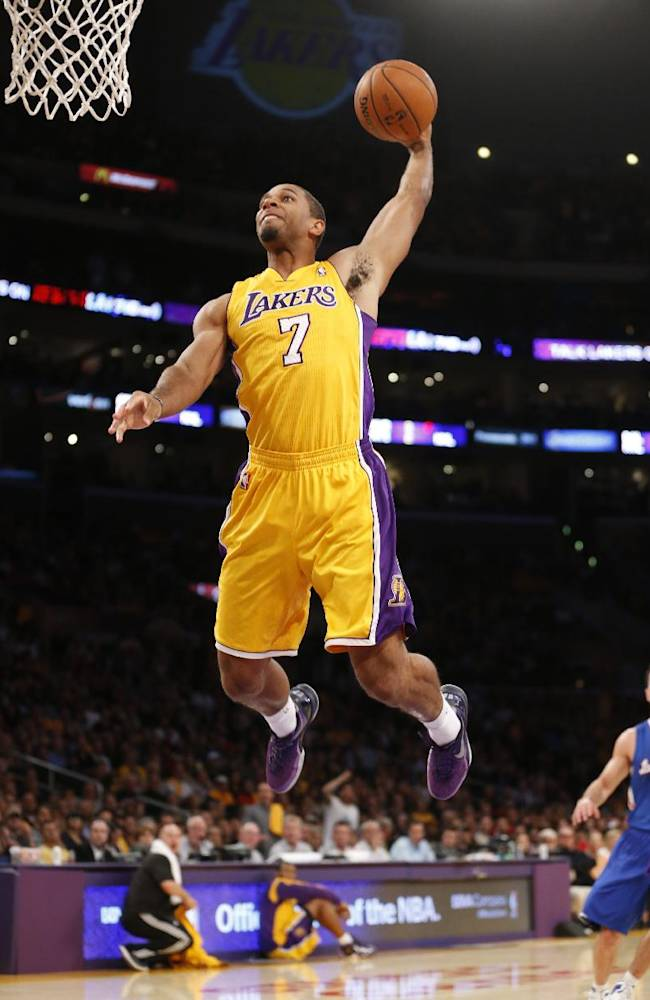 Los Angeles Lakers' Xavier Henry dunks the ball against the Los Angeles Clippers during the first half of an NBA basketball game in Los Angeles, Tuesday, Oct. 29, 2013
