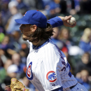 Chicago Cubs starter Jeff Samardzija throws against the Philadelphia Phillies during the first inning of a baseball game in Chicago, Saturday, April 5, 2014 The Associated Press