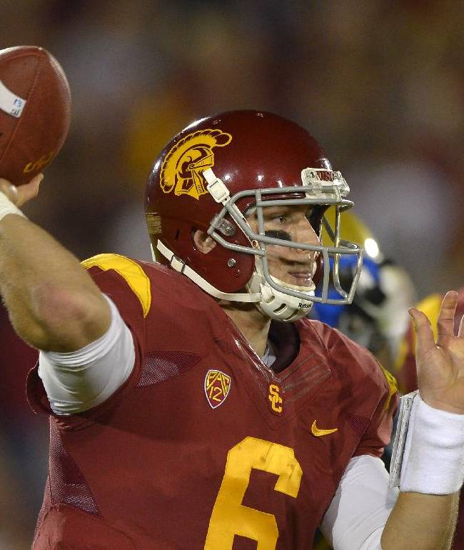 Southern California quarterback Cody Kessler passes during the second half of an NCAA college football game against UCLA, Saturday, Nov. 30, 2013, in Los Angeles. UCLA won 35-14