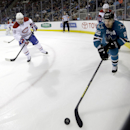 CORRECTS DAY OF WEEK - San Jose Sharks defenseman Dan Boyle (22) chases down a puck along the boards as Montreal Canadiens center Daniel Briere (48) defends during the first period of an NHL hockey game Saturday, March 8, 2014, in San Jose, Calif The Asso