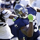 Seattle Seahawks' Ricardo Lockette, right, tries to stay out of reach of Richard Sherman during a drill at an NFL football camp practice Wednesday, July 30, 2014, in Renton, Wash The Associated Press