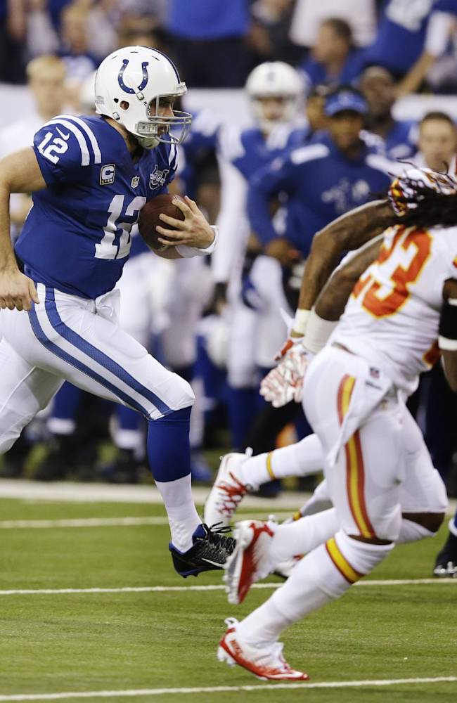 Indianapolis Colts' Andrew Luck (12) runs during the first half of an NFL wild-card playoff football game against the Kansas City Chiefs Saturday, Jan. 4, 2014, in Indianapolis