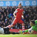 Tottenham Hotspur goalkeeper Hugo Lloris, right, and defender Younes Kaboul, left, fail to stop Southampton's Jay Rodriguez, from scoring his team's opening goal during the English Premier League match at White Hart Lane, London Sunday March 23, 2014. (