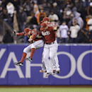 Arizona Diamondback outfielders, from left, Mark Trumbo, A.J. Pollock, and Gerardo Parra celebrate after a baseball game against the San Francisco Giants Wednesday, April 9, 2014, in San Francisco. Arizona won, 7-3 The Associated Press