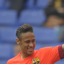 FC Barcelona's Neymar, from Brazil, left, reacts after scoring with his teammate Lionel Messi, from Argentina, against Espanyol during a Spanish La Liga soccer match at Cornella-El Prat stadium in Cornella Llobregat, Spain, Saturday, April 25, 2015. (AP Photo/Manu Fernandez)