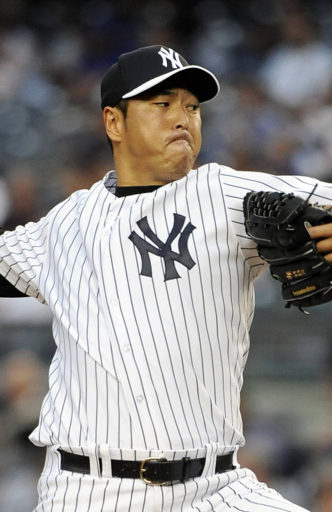New York Yankees starting pitcher Hiroki Kuroda winds up a pitch against the New York Mets in the first inning of an interleague baseball game at Yankee Stadium on Monday, May 12, 2014, in New York