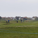 Golfers play at Royal Liverpool Golf Club before the British Open golf championships, Hoylake, England, Wednesday, April 23, 2014. The 2014 Open Championship which will be played at Royal Liverpool from July 17-20, 2014