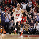 Chicago Bulls forward Taj Gibson (22) celebrates after his dunk off a rebound during the second half of an NBA basketball game against the Indiana Pacers Monday, March 24, 2014, in Chicago. The Bulls won 89-77 The Associated Press
