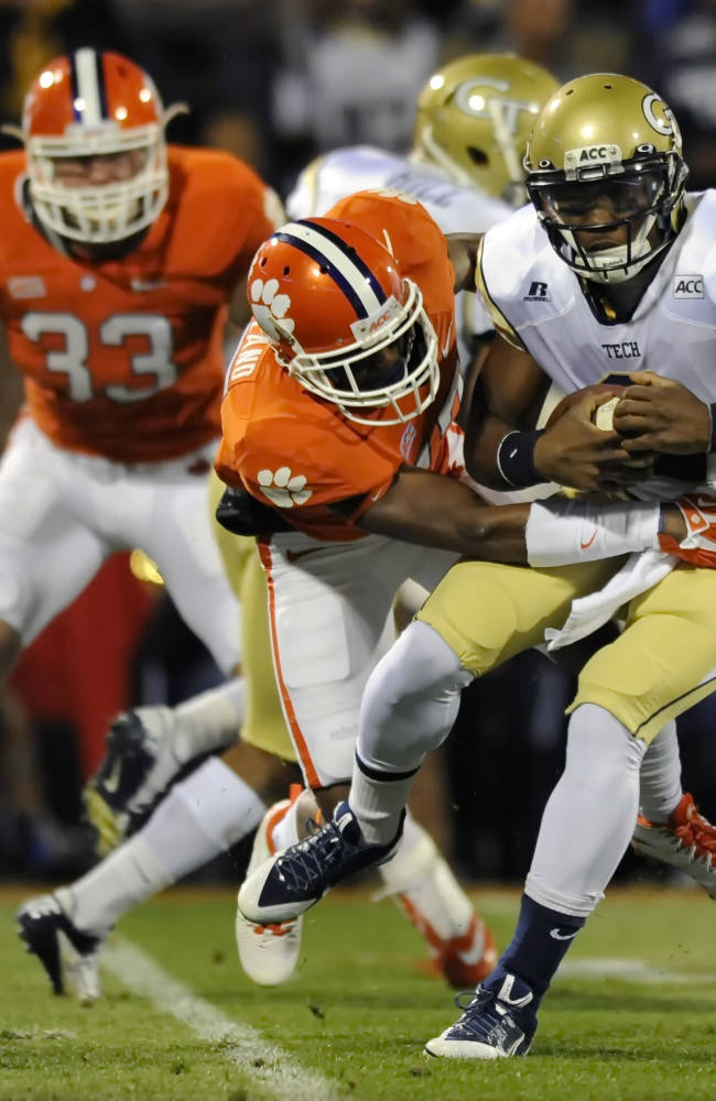 Georgia Tech quarterback Vad Lee is sacked by Clemson's Bashuad Breeland during the first half of an NCAA college football game on Thursday, Nov. 14, 2013, in Clemson, S.C