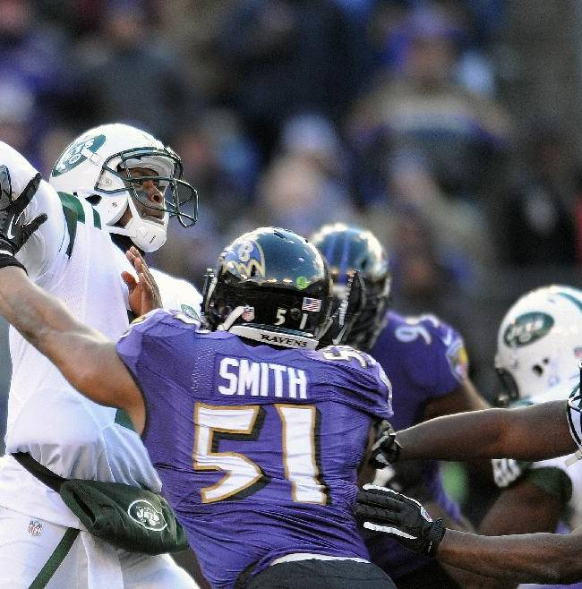 New York Jets quarterback Geno Smith, left, passes the ball under pressure from Baltimore Ravens inside linebacker Daryl Smith (51) during the first half of an NFL football game in Baltimore, Md., Sunday, Nov. 24, 2013