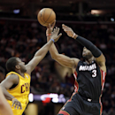 Miami Heat's Dwyane Wade (3) shoots over Cleveland Cavaliers' Dion Waiters in the fourth quarter of an NBA basketball game Wednesday, Nov. 27, 2013, in Cleveland. Wade scores 22 points in Miami's 95-84 win The Associated Press