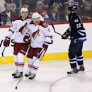 Arizona Coyotes' Oliver Ekman-Larsson, left, and Shane Doan (19) celebrate after Ekman-Larsson scored against the Winnipeg Jets during the first period of an NHL hockey game, Sunday, Jan. 18, 2015, in Winnipeg, Manitoba The Associated Press