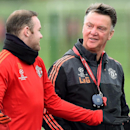 Manchester United manager Louis van Gaal, right, talks with Wayne Rooney during a training session at the team's training complex in Manchester, England, Tuesday Nov. 24, 2015. United will play PSV Eindhoven in a Champions League soccer match on Wedne