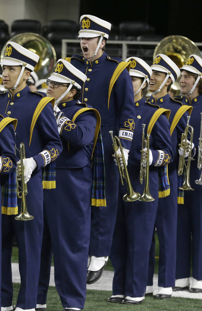 The Notre Dame band waits to head onto the field before the team's NCAA college football game against Arizona State on Saturday, Oct. 5, 2013, in Arlington, Texas