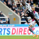Newcastle United's Moussa Sissoko, left, has a shot towards goal past Aston Villa's Fabian Delph, right, during their English Premier League soccer match at St James' Park, Newcastle, England, Sunday, Feb. 23, 2014