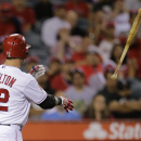 Los Angeles Angels' Josh Hamilton tosses his bat after striking out during the seventh inning of a baseball game against the Seattle Mariners in Anaheim, Calif., Tuesday, June 18, 2013. (AP Photo/Jae C. Hong)
