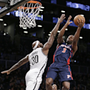 Detroit Pistons guard Rodney Stuckey (3) goes up for a layup as Brooklyn Nets forward Reggie Evans (30) defends in the second half of an NBA basketball game, Sunday, Nov. 24, 2013, in New York The Associated Press