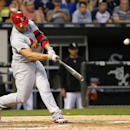 Holliday's grand slam sends Cardinals over White Sox The Associated Press
