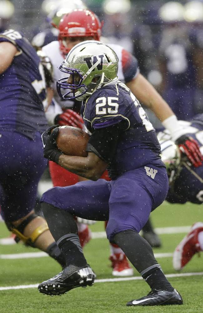 Washington's Bishop Sankey (25) runs the ball during the first half of an NCAA college football game against Arizona, Saturday, Sept. 28, 2013, in Seattle