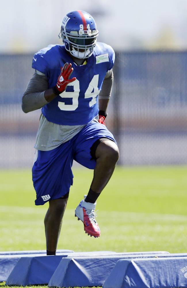 In this photo taken Wednesday, Sept. 18, 2013, New York Giants defensive end Mathias Kiwanuka works out during NFL football practice in East Rutherford, N.J.,  Two weeks into the season, the Giants are still looking for a pass rush. The defensive line will have another chance on Sunday, when they travel to face the Carolina Panthers
