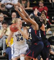 Duke forward Kathleen Scheer (24) gets pressure from Samford forward J'Quita Babineaux (22) in the first half of an NCAA women's college basketball tournament first-round game, Sunday, March 18, 2012, in Nashville, Tenn. (AP Photo/John Russell)