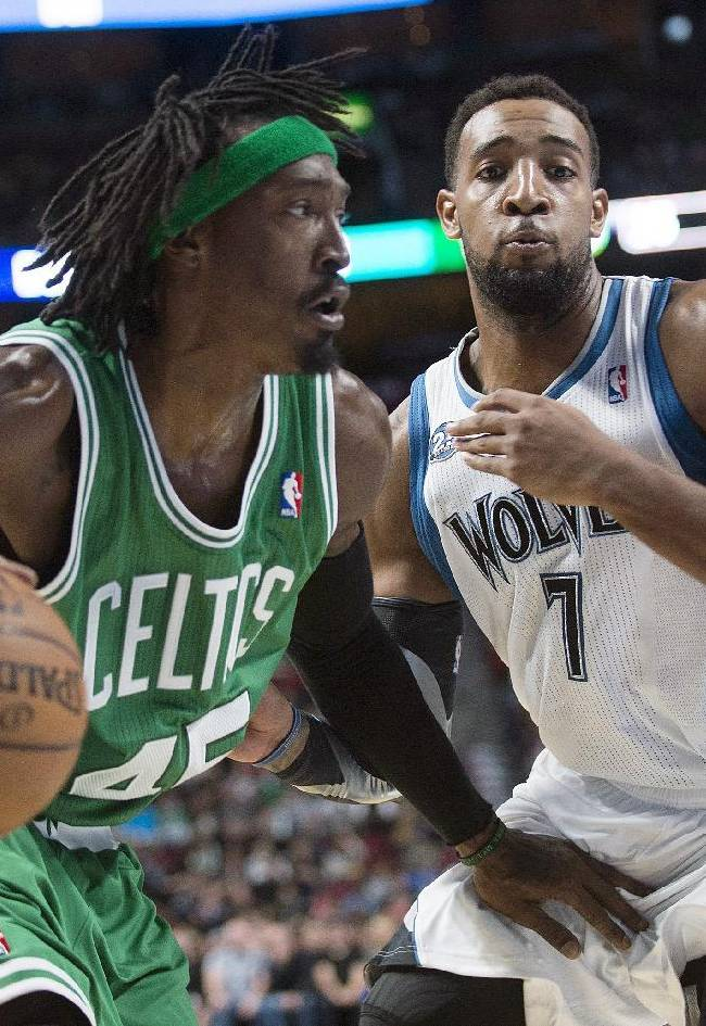 Boston Celtics' Gerald Wallace, left, drives to the net as Minnesota Timberwolves' Derrick Williams defends during the second quarter of an NBA preseason basketball game in Montreal, Sunday, Oct. 20, 2013