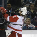 Detroit Red Wings' Brendan Smith, right, and San Jose Sharks' Tomas Hertl trade punches during the first period of an NHL hockey game Thursday, Feb. 26, 2015, in San Jose, Calif. (AP Photo/Ben Margot)