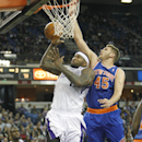 Sacramento Kings center DeMarcus Cousins (15) drives to the basket against New York Knicks defender Cole Aldrich (45) during the second half of an NBA basketball game in Sacramento, Calif., on Wednesday, March 26, 2014.The Knicks won 107-99 The Associated