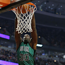 Boston Celtics forward Brandon Bass dunks against the Chicago Bulls during the first half of an NBA basketball game in Chicago, Monday, March 31, 2014 The Associated Press