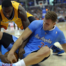 Indiana Pacers center Ian Mahinmi, left, of France, and Los Angeles Clippers forward Blake Griffin battle for a loose ball during the second half of an NBA basketball game, Sunday, Dec. 1, 2013, in Los Angeles The Associated Press