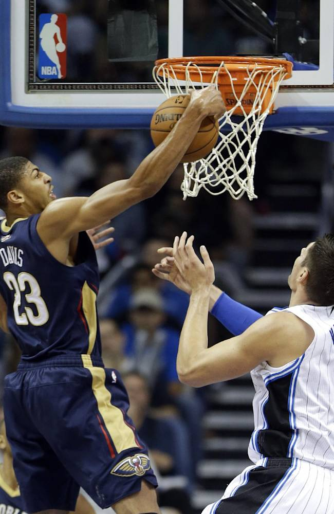 New Orleans Pelicans' Anthony Davis (23) grabs an offensive rebound away from Orlando Magic's Nikola Vucevic (9), of Montenegro, during the first half of an NBA basketball game in Orlando, Fla., Friday, Nov. 1, 2013