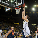 Michigan forward Mark Donnal, right, makes a basket over Bucknell defenders in the first half of an NCAA college basketball game at Crisler Center in Ann Arbor, Mich., Monday, Nov. 17, 2014. (AP Photo/Tony Ding)
