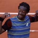 France's Gael Monfils reacts shortly after defeating Czech Republic's Tomas Berdych during their first round match of the French Open tennis tournament at the Roland Garros stadium Monday, May 27, 2013 in Paris. (AP Photo/Petr David Josek)