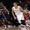 Houston Rockets' Jeremy Lin (7) drives the ball around Atlanta Hawks' DeMarre Carroll (5) in the first quarter of an NBA basketball game Wednesday, Nov. 27, 2013, in Houston. Lin left the game in the first quarter and did not return. The Rockets won 113-8