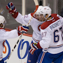 Montreal Canadiens' David Desharnais, from left to right, Dale Weise and Max Pacioretty celebrate Pacioretty's tying goal against the Vancouver Canucks during the third period of an NHL hockey game, Thursday, Oct. 30, 2014 in Vancouver, British Columbia T