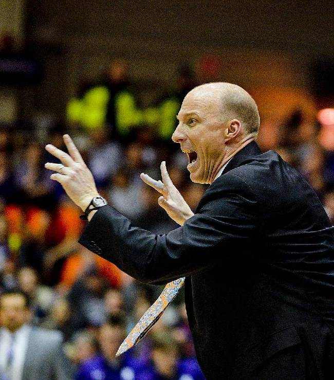 Illinois head coach John Groce  yells during the second half of an NCAA college basketball game against Northwestern in Evanston, Ill., on Sunday, Jan. 12, 2014